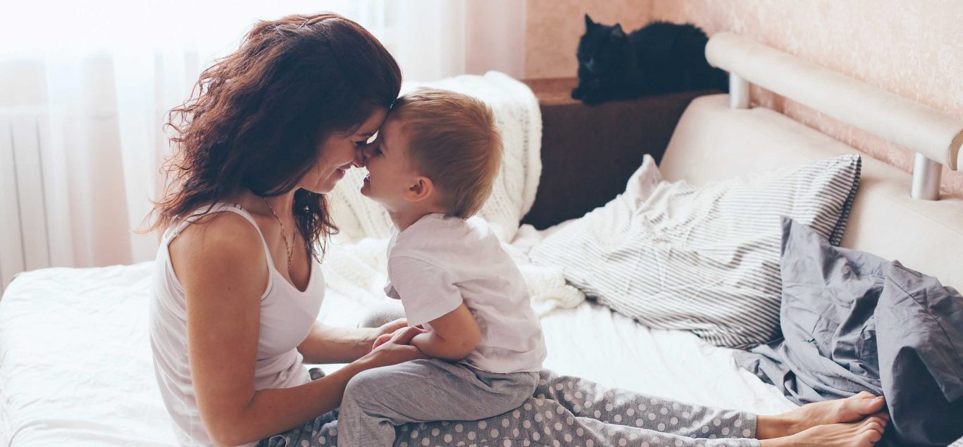 Mother and child on bed